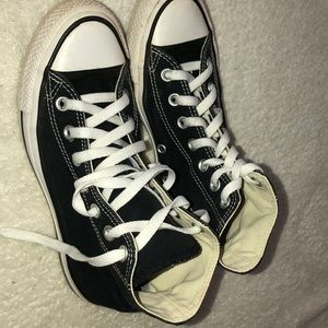 Chuck Taylor Converse. Size 5 in men's.